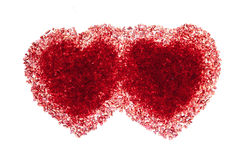 Two ruby red hearts Stock Photos