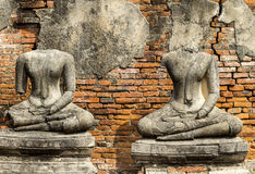 Two ruin Buddha images with ancient wall Royalty Free Stock Photo