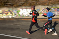 Two runners. Blurred background Royalty Free Stock Image