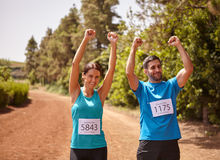 Two runners celebrating the race final Stock Image
