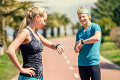 Two runners checked results of run distance Stock Photography