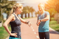 Two runners checked results of run distance Royalty Free Stock Photos