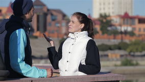 Two runners man and woman talking before jogging. Concept about urban running, sport, fitness and people. Urban sports - couple jogging for fitness in the city stock footage