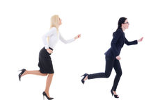 Two running business women in business suit isolated on white. Background Royalty Free Stock Photos
