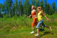 Two running girls. Two girls running on a meadow Royalty Free Stock Image