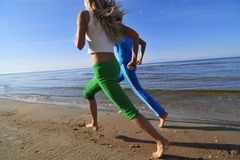 Two running girls stock photography