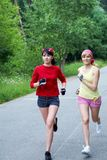 Two running woman Royalty Free Stock Image