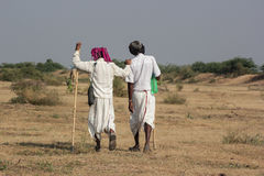 Two Rural Indian traditional attire. Men in photo are of Bharwad community a tribe of Gujarat, India. They live kind of nomads life. A Indian gypsy man at work Royalty Free Stock Image