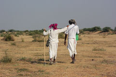 Two Rural Indian traditional attire. Men in photo are of Bharwad community a tribe of Gujarat, India. They live kind of nomads life. A Indian gypsy man at work Stock Images