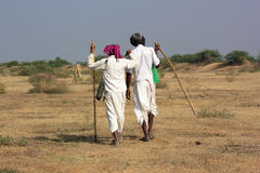 Two Rural Indian traditional attire. Men in photo are of Bharwad community a tribe of Gujarat, India. They live kind of nomads life. A Indian gypsy man at work Stock Image