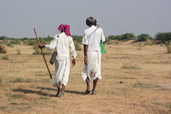 Two Rural Indian traditional attire. Men in photo are of Bharwad community a tribe of Gujarat, India. They live kind of nomads life. A Indian gypsy man at work Royalty Free Stock Photo