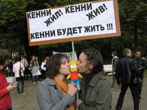 Two russian girls on a protest with Simpson Stock Photo