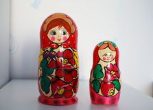Two Russian matryoshka dolls are on the table Royalty Free Stock Images