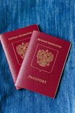 Two Russian passport to travel on a blue background stock photos