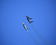 Two Russian Su-27 fighters carry out a joint maneuver royalty free stock image