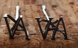 Two rustic branding irons for cattle Royalty Free Stock Images