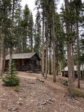 1920s dude ranch cabins at national park. These two rustic log cabins are part of a former 1920s dude ranch inside the Rocky Mountain National Park in Colorado stock photography