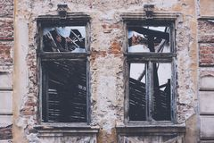 Two rustic windows. Old haunted house two windows royalty free stock photo