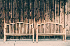 Two Rustic Wooden Log Benches - Retro Royalty Free Stock Images