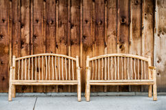 Two Rustic Wooden Log Benches Royalty Free Stock Image