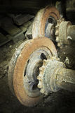 Two rusty axles. Littered in a waste Royalty Free Stock Photo