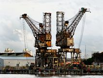 Two rusty cranes Royalty Free Stock Photography