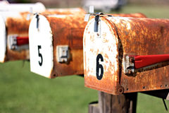 Two rusty mailboxes. With numbers on them Royalty Free Stock Photo