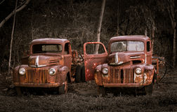 Two rusty old Ford trucks Stock Photo