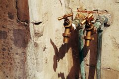 Two rusty water taps Royalty Free Stock Images