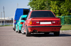Two 80s old sports car on the road Stock Images