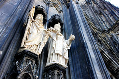 Two sacred sculptureon Cologne Cathedral. Two sacred sculpture on Cologne Cathedral, with a angel from bottom to top Royalty Free Stock Photo