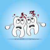 Two sad Cartoon human teeth. With caries on their heads Stock Photos