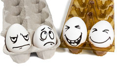Two sad and cheerful couple eggs Royalty Free Stock Images