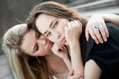 Two sad girls sorry for each other. Outdoors royalty free stock image