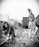 Two sad grunge girls at a railroad Stock Image