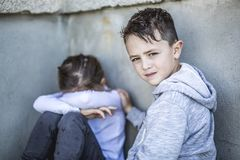 Six years old sad school at the schoolyards Stock Photography