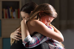 Free Two Sad Teens Embracing At Bedroom Stock Photo - 96415230