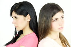 Two sad women angry at each other not talking isolated closeup Stock Photography