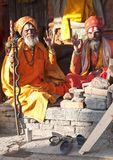 Two sadhus seeking alms in Pashupatinath, Nepal royalty free stock photos