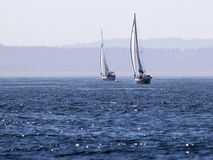 Two Sailboats on Deep Blue Water Stock Photos