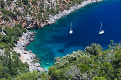 Two sailboats in idyllic small bay Stock Photos
