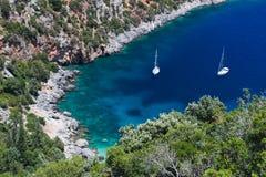 Two sailboats in idyllic small bay stock photos