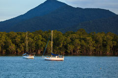 Two Sailboats Moored in Cairns Harbor. At Sunrise Stock Photo
