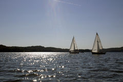 Two sailboats racing Stock Images