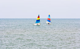 Two sailboats racing Stock Photos