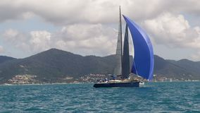 Two sailboats sailing. The great blue sea. The shot is taken in slow motion stock video footage