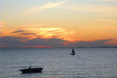 Two Sailboats in the Sea at Sunset Stock Photography