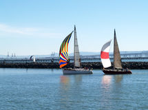 Two Sailboats under Spinnakers running into port Royalty Free Stock Images