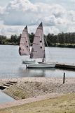 Two sailboats on the water Stock Photography