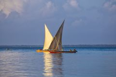 Two sailboats on the water surface. Zanzibar island , Tanzania, Africa. Ancient wooden sailing boats with people on board on the sea surface at the morning stock photos